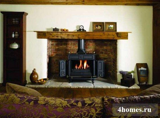 Камин - украшение современной гостиной в квартире или частном доме